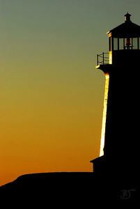 Day 263 - Lighthouse Silhouette   I was trying different compositions of Peggy's Cove lighthouse.  This was one of my favorites that day.   Dec 04 2008
