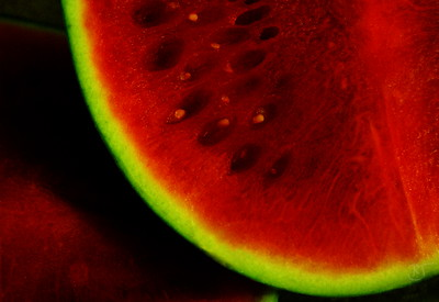Day 122 - Fresh Cut Watermelon   I love watermelon in the summer, especially ice cold. :P  I like to cut it into chunks and put it in the fridge for a while.  When I cut into this melon, I thought the growth lines were really neat. So I took some shots before slicing and dicing it.  So hard to find seeded watermelons these days - just glad they are still round - wonder why the square ones never caught on here ... yet.  As I finished putting the last chunks into the containers, Barb nonchalantly scarfed them before I got to sample the goods. hehe  Well, I did sample one or two - who can resist.   June 17 2008